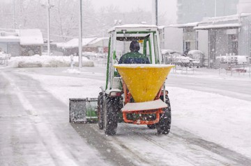 Commercial Snow Removal Mini Tractor spreading salt