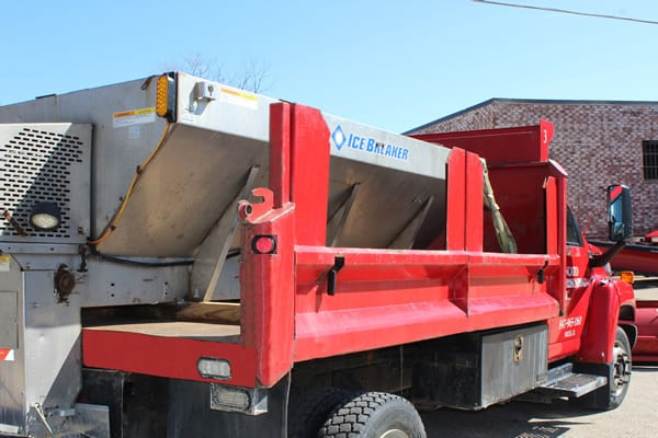 Salt or sand spreader on truck