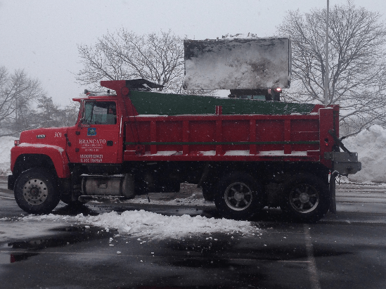 Chicago Snow Removal Truck being loaded with snow to be hauled away.